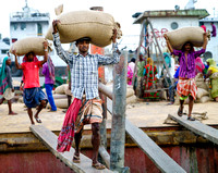 Unloading ships in Chittagong port